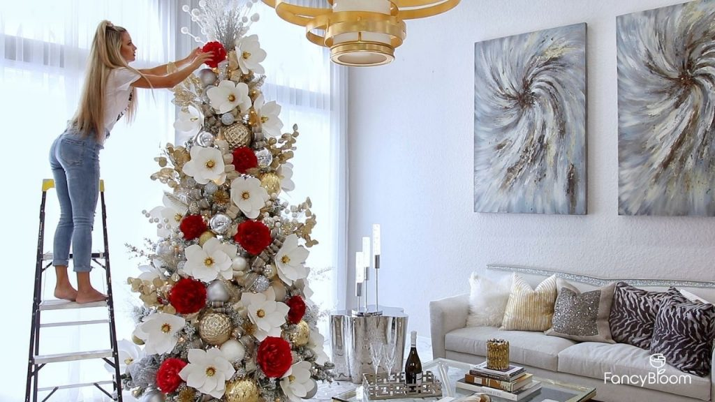 Christmas tree decorating with paper flowers